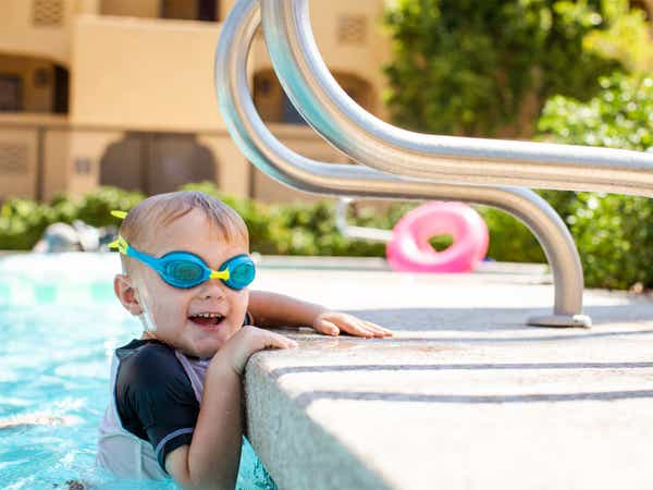 Young child wearing goggles in pool at Scottsdale Resort in Scottsdale, Arizona.