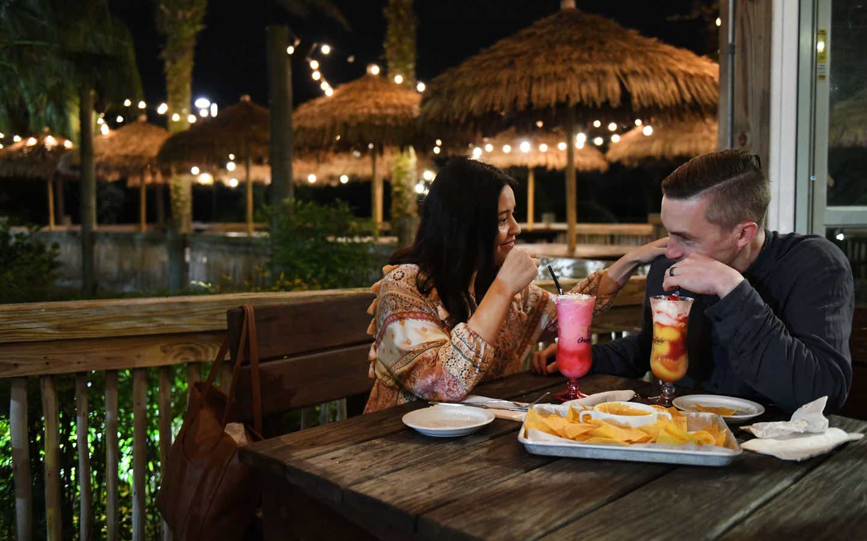 Couple eating at Tradewinds Bar & Grill at Orange Lake Resort near Orlando, Florida.