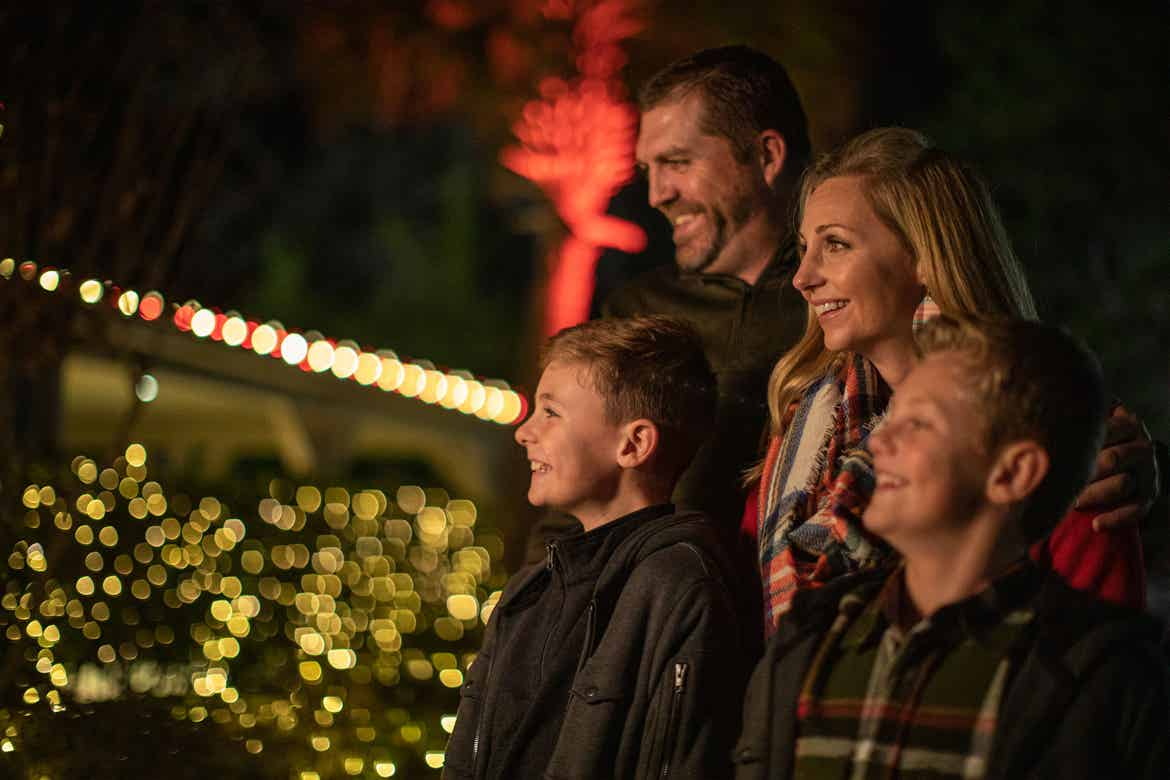 Author, Amanda Nall (right), and her family look at the string lights and enjoy being surrounded by holiday decor.