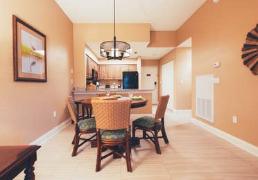 Dining table with four chairs in a one bedroom villa in North Village at Orange Lake Resort near Orlando, Florida
