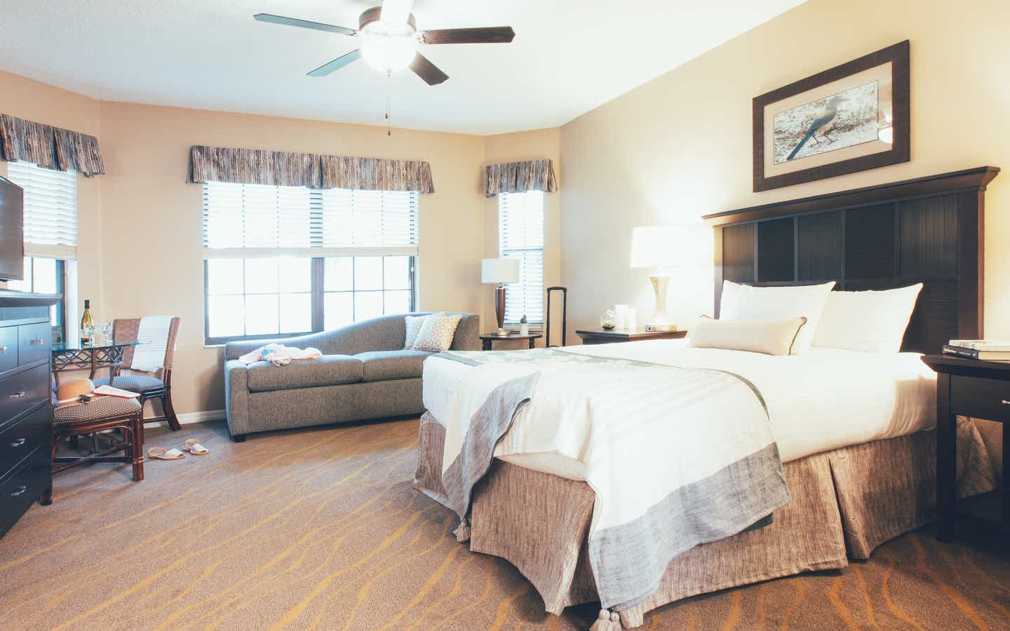 Bedroom with seating area and three windows in a three bedroom villa in North Village at Orange Lake Resort near Orlando, Florida