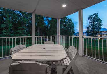 Porch with an outdoor table in a two-bedroom presidential villa at the Holiday Hills Resort in Branson Missouri.