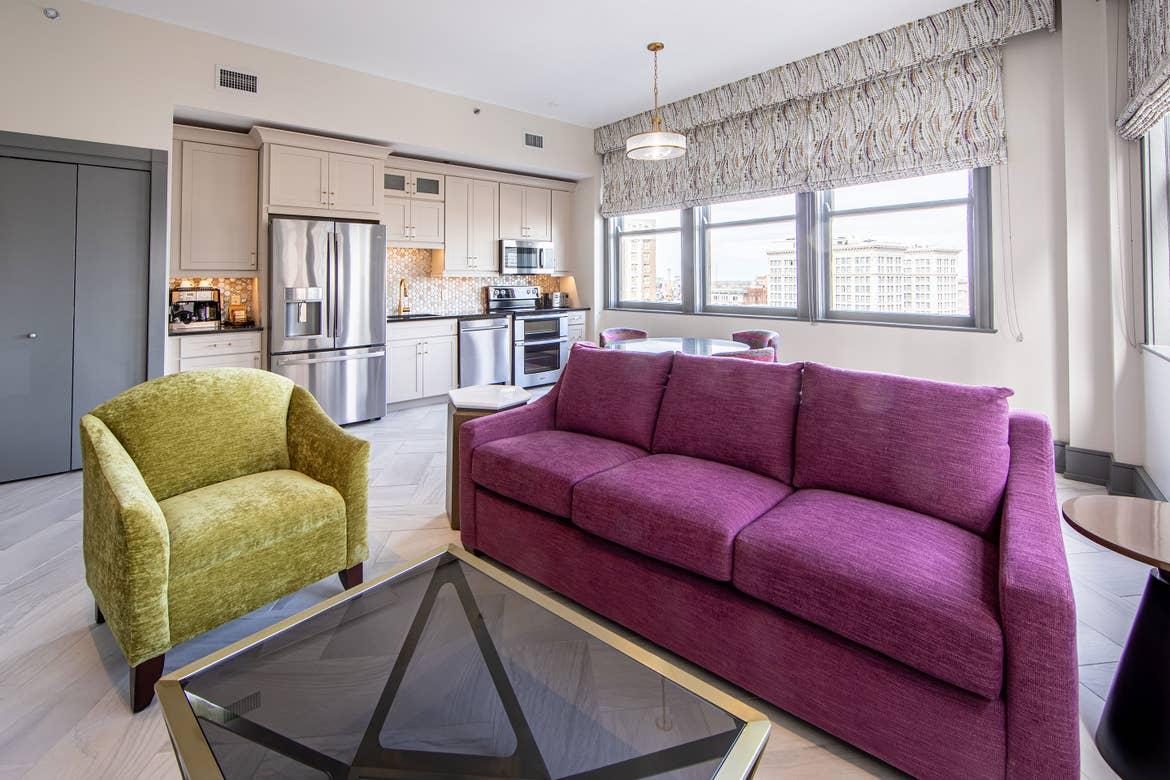 An interior shot of our Signature Collection villa with green and purple furnishings in our New Orleans resort located in Louisiana.