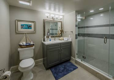 A bathroom in a four-bedroom Signature Collection villa at Cape Canaveral Resort