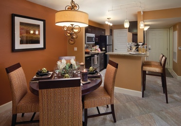 Kitchen and dining area in a two-bedroom villa at Desert Club Resort