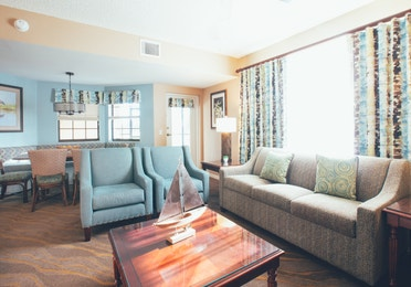 Living room with couch and two accent chairs in a villa in North Village at Orange Lake Resort near Orlando, Florida