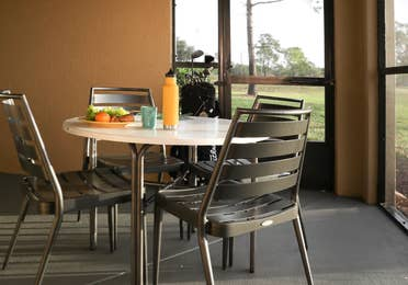 Furnished balcony with table and four chairs in a villa in North Village at Orange Lake Resort near Orlando, Florida