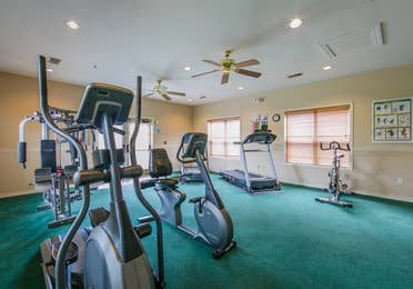 Fitness Center with ellipticals, stationary bikes and treadmills at Holiday Hills Resort in Branson, Missouri