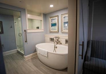Bathroom with tub and walk-in shower in a two-bedroom Signature Collection villa at Cape Canaveral Beach Resort.