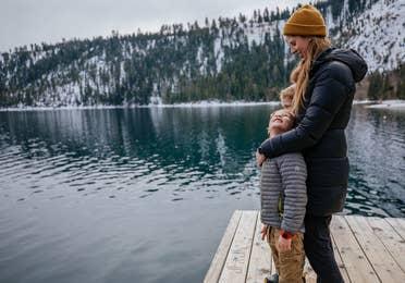 Mom and child looking at Lake Tahoe near Tahoe Ridge Resort in Stateline, Nevada.