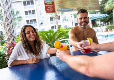 Two adults getting drinks at Splash Cove at South Beach Resort in Myrtle Beach, South Carolina.