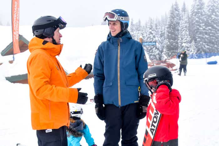 Jessica's Husband (middle) and children talk with the Resort Ski Instructor (left) prior to hitting the slopes.