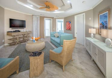 Living room with a view of the TV in a two-bedroom Signature Collection villa at Galveston Seaside Resort