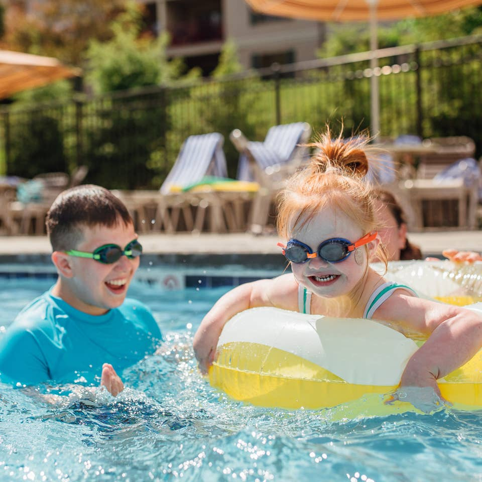 Kids swimming in outdoor pool at Oak n' Spruce Resort in South Lee, Massachusetts.