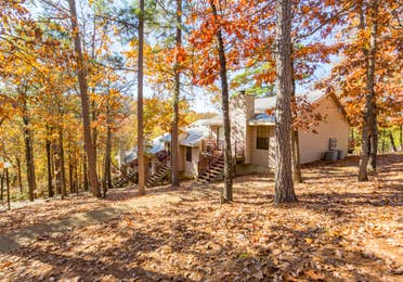 View of property building among fall foliage at Ozark Mountain Resort in Kimberling City, MIssouri.