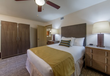 Guest bedroom with wardrobe in a two-bedroom villa at Scottsdale Resort