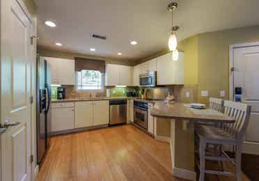 Kitchen with dining bar area in a two-bedroom ambassador villa at the Holiday Hills Resort in Branson Missouri.