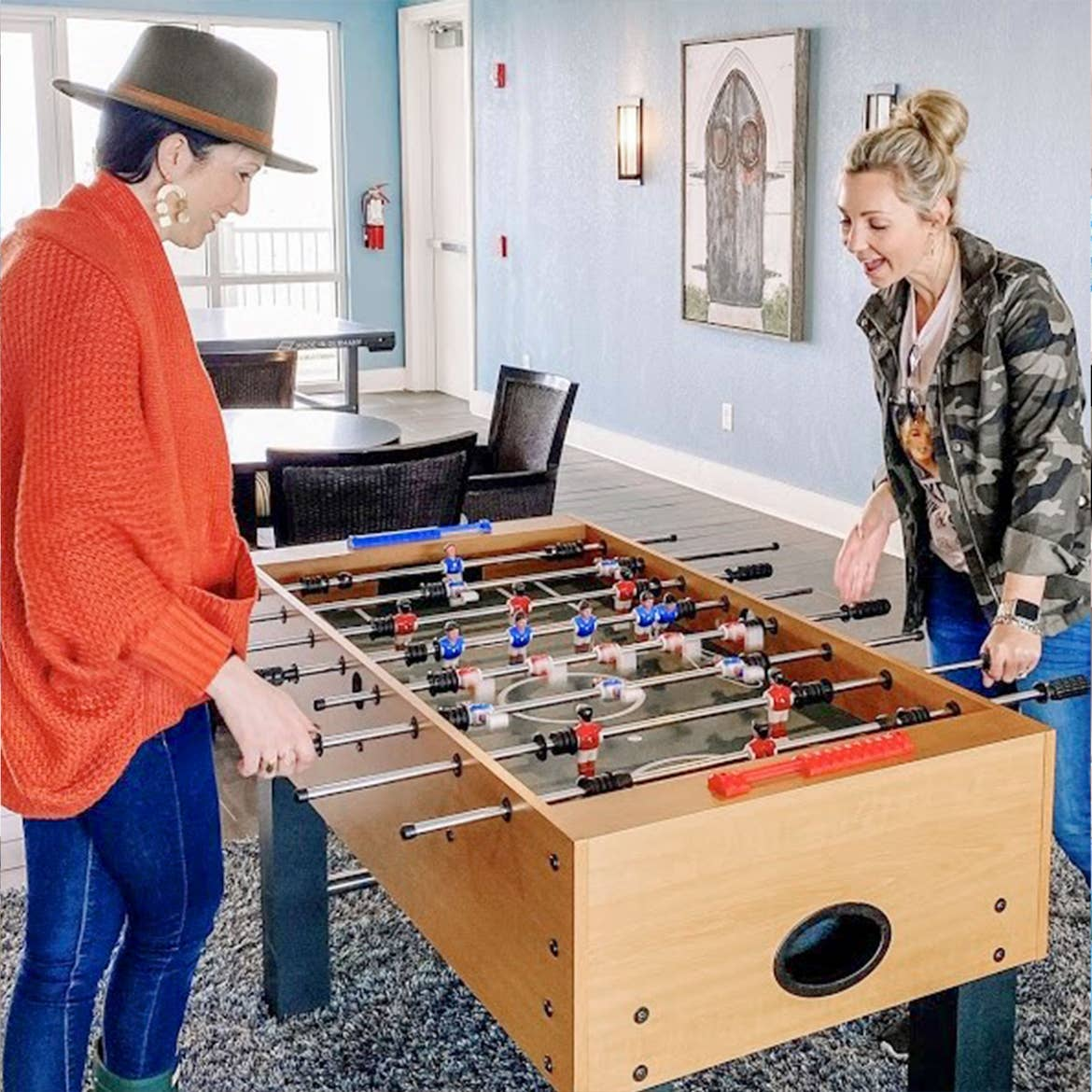 Featured Contributor, Amanda Nall (right) plays foosball with her friend at our Galveston Beach Resort in Galveston, Tx.