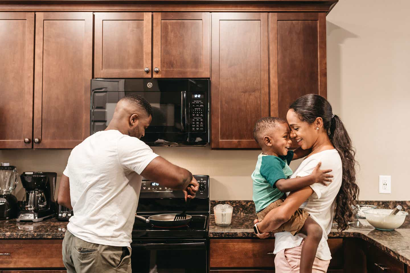 Asekey Bonnair making breakfast at our Williamsburg Resort with his wife and son.