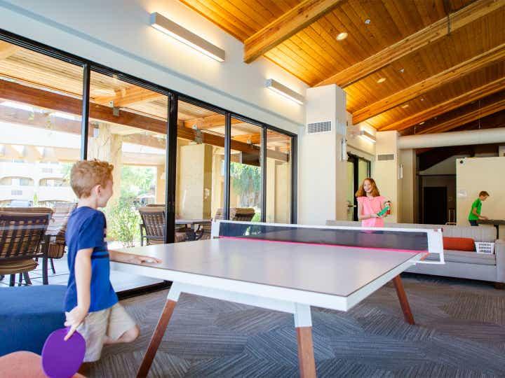 Children playing ping pong at Scottsdale Resort in Scottsdale, Arizona.