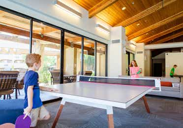 Children playing ping pong at Scottsdale Resort in Scottsdale, Arizona.