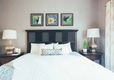 Bed and two night stands in a one bedroom villa in North Village at Orange Lake Resort near Orlando, Florida