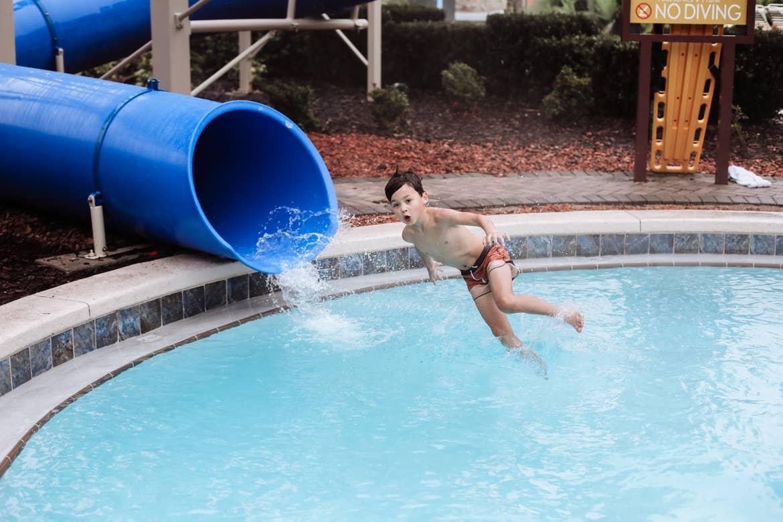 Mia's son on a waterslide