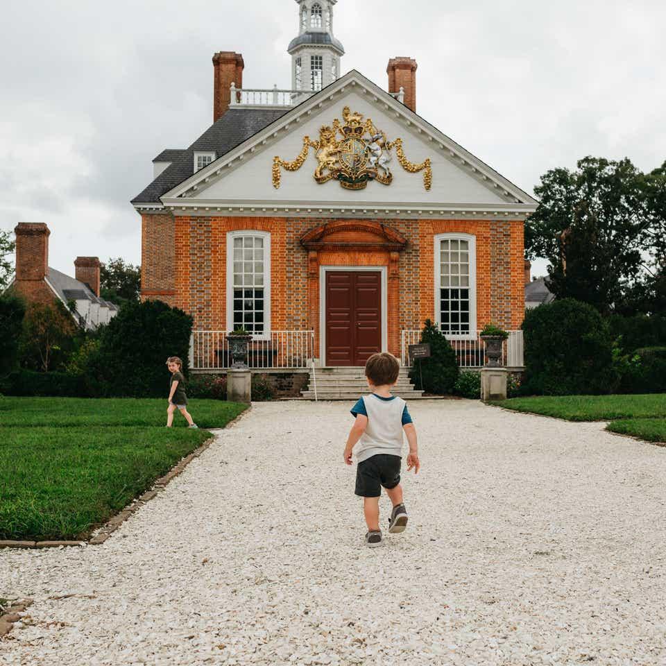 Small child exploring in Williamsburg, Virginia.