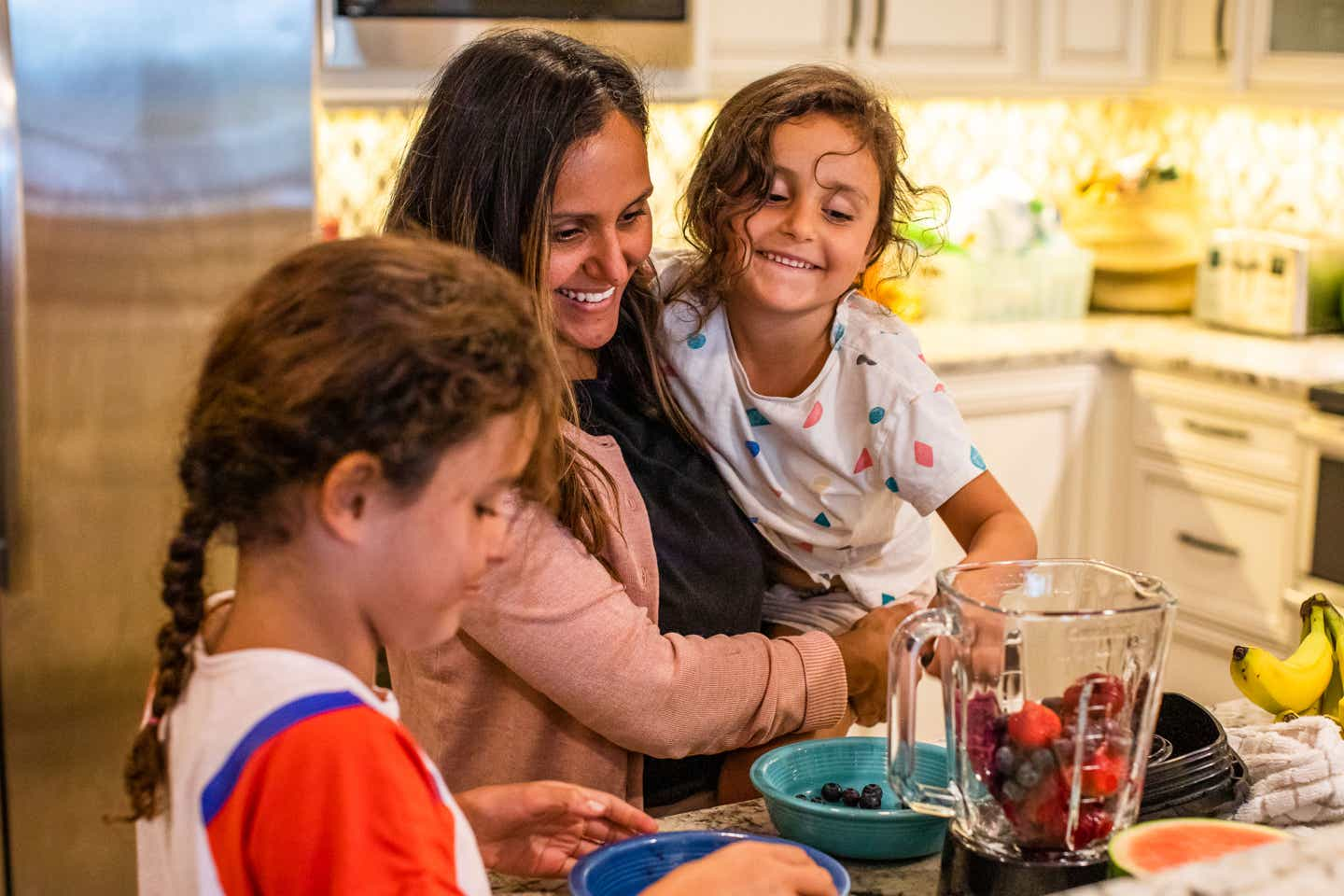Brenda Rivera Sterns' family put mixed berries into a blender to make smoothies in the kitchen of our Signature Collection villa at our South Beach Resort in Myrtle Beach, South Carolina.