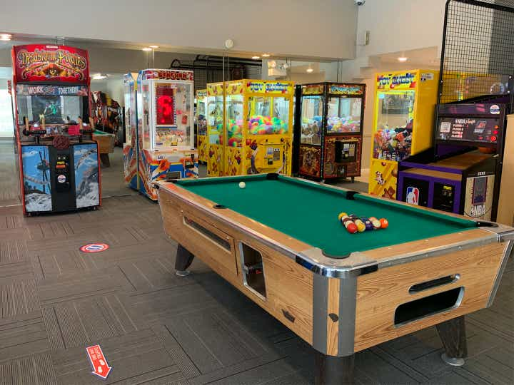 Game room with pool table and arcade games at Desert Club Resort in Las Vegas, Nevada.