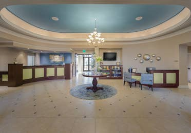 Lobby view with front desk and comfortable seating area at Sunset Cove Resort