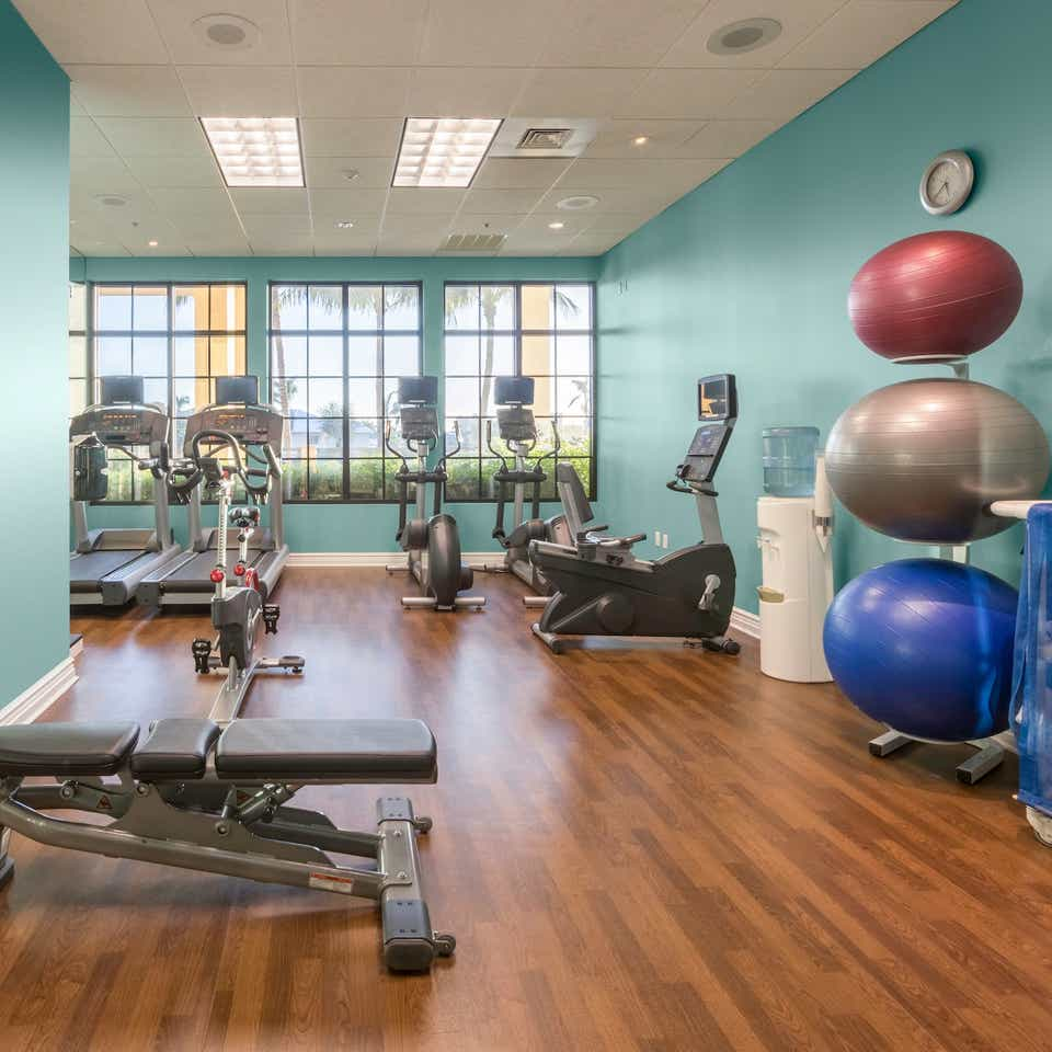 Fitness center with treadmills, yoga balls and weights at Sunset Cove Resort in Marco Island, FL.