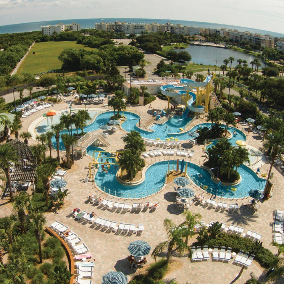Aerial view of pools and lazy river at Cape Canaveral Beach Resort.