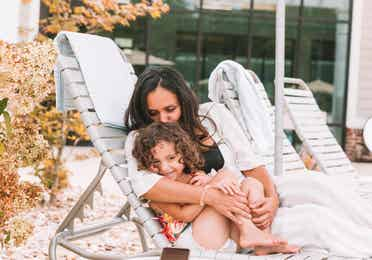 Mother and daughter sitting in a pool chair at Williamsburg Resort