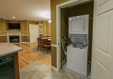 View of washer and dryer amenities in a two-bedroom ambassador villa at the Hill Country Resort in Canyon Lake, Texas.
