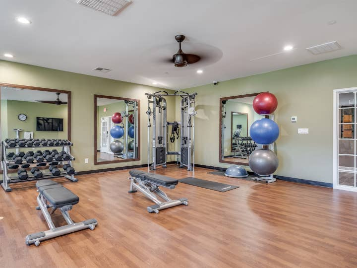 Fitness center with yoga balls and free weights at Piney Shores Resort in Conroe, Texas.
