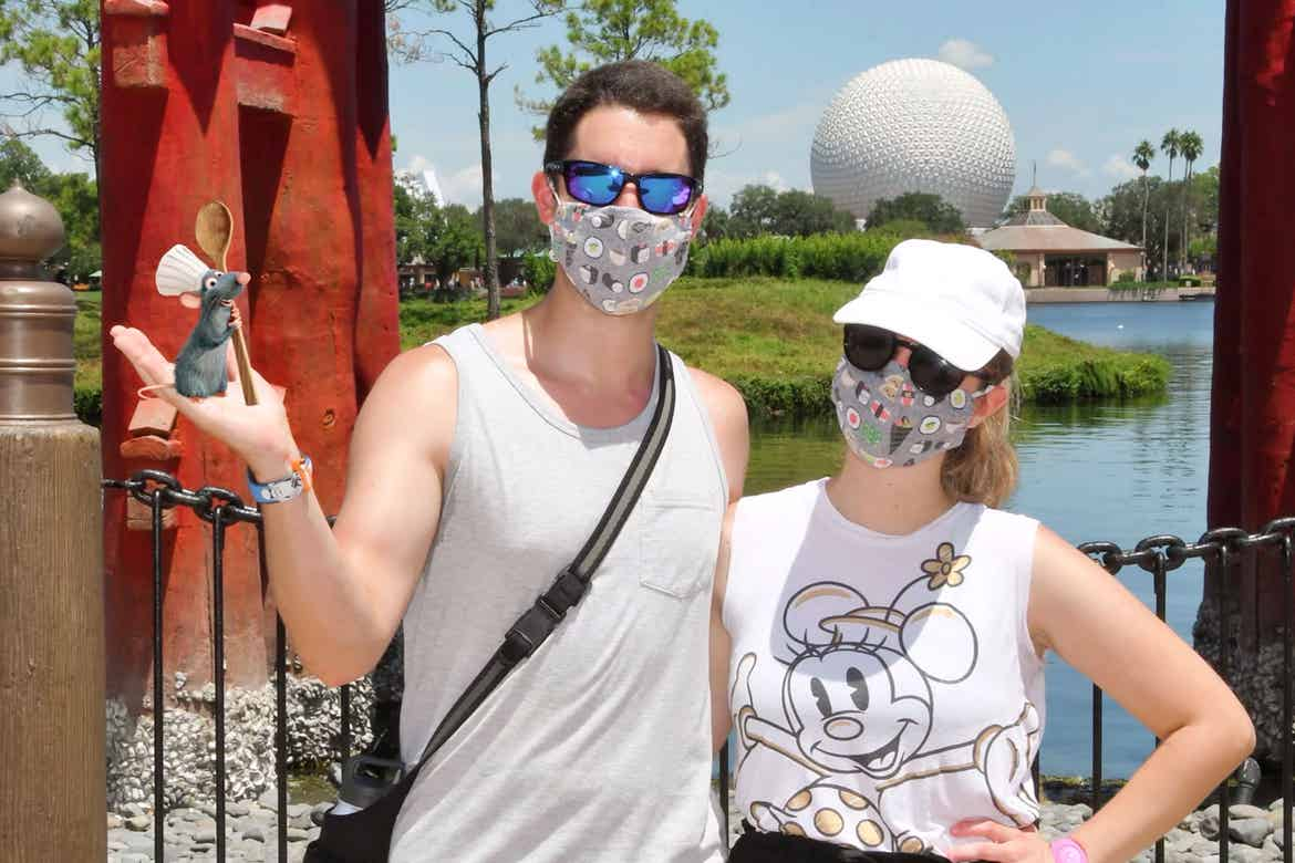 Featured author, Jessica Salina, with husband, Anthony, in Epcot World Showcase-Japan Pavilion get photobombed by Remy from Pixar's 'Ratatouille.'
