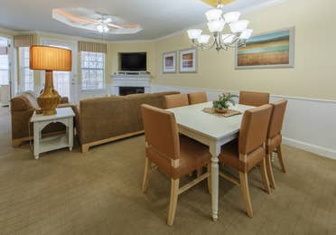 Dining area and living room in a two-bedroom presidential villa at Apple Mountain Resort