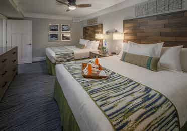 Two beds in a guestroom in a four-bedroom Signature Collection villa at Cape Canaveral Resort