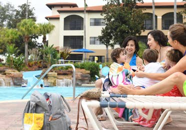 Raff with her family by the pool at Orange Lake Resort