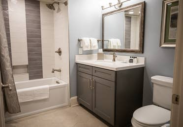 Bathroom with shower/tub combination in a two-bedroom Signature Collection villa at Cape Canaveral Beach Resort.