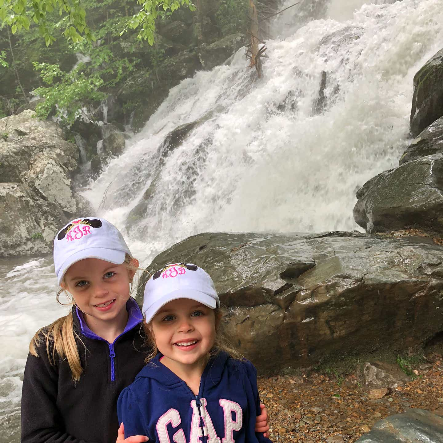 Author, Chris Johnstons' daughters, Kyndall (left), and Kyler (right) pose near the Dark Hollow Falls located at Shenandoah National Park in Virginia.