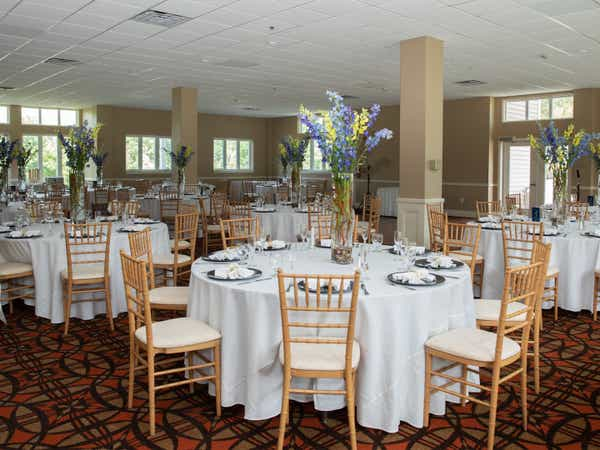 Round tables with white table cloths and place settings at Mount Ascutney Resort in Brownsville, Vermont.