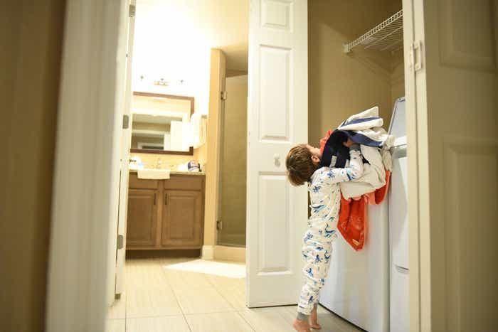 Raff's son doing laundry in villa