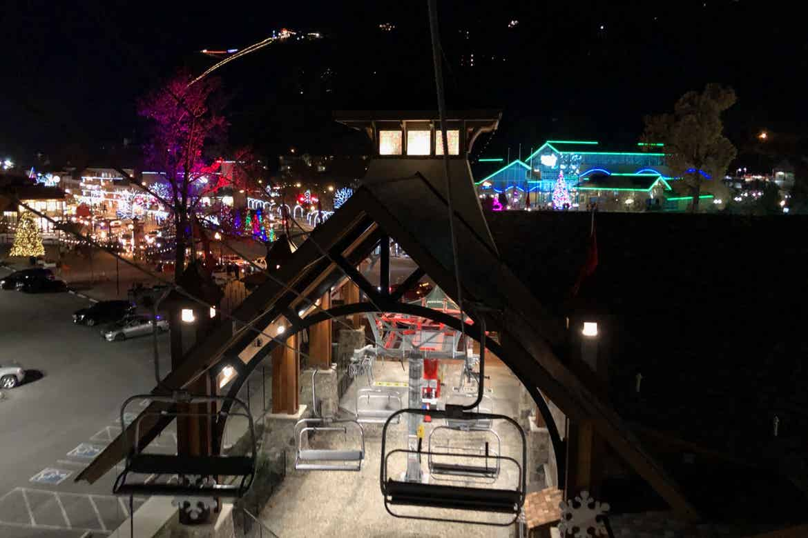 Anakeesta's property all lit up for Christmas with thousands of lights seen from the chair lift.