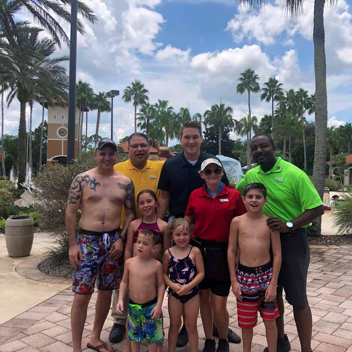 Featured Member, Sara Perezes family stands with several HICV Team Members outside of our River Island pool.
