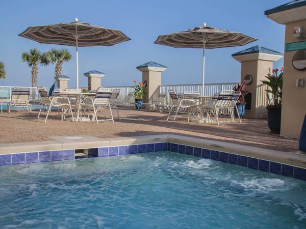 Outdoor pool with covered seating at Panama City Beach Resort in Florida.