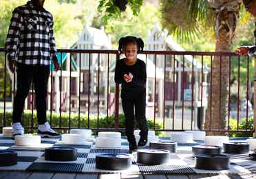 Toddler playing a jumbo-sized game of checkers