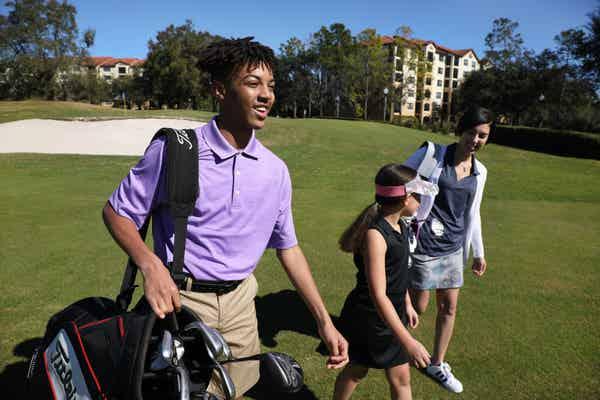 Golfers walking on course at Orange Lake Resort near Orlando, Florida