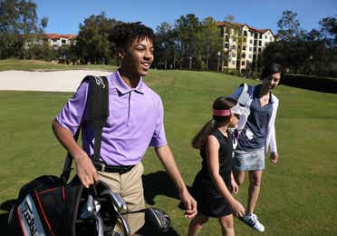 Golfers walking on course at Orange Lake Resort near Orlando, Florida